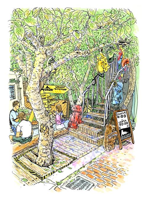 キャットストリートの一角、木に隠れる様な階段を上る、バックパック専門店グレゴリー。黄色いサインボードにはグレゴリーUSA本社まで8000kmと。
