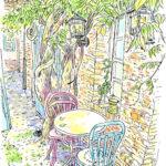 ヴィダメの中庭。藤の木が若い蔓を伸ばし煉瓦の壁を彩っている。風が吹く度柔らかく揺れ、テーブルに落ちる木漏れ日。客の途切れた午後、明るい中庭を独り占め。 Les Jardins du Vidame、Gerberoy