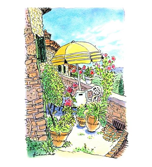 サン・ジミニャーノの町を歩いていたら、小さな石の家の庭にパラソルが出ていました。小さな明かりとりの窓から話し声が聞こえて、石の町に温かさを感じました。