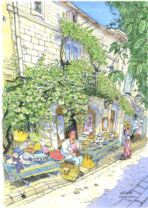 素敵なマダムが店番をしているアルル・ヴォルテール通りの帽子屋さん。葡萄の蔓が二階の窓まで絡みつき風に煽られてきらめいている。3階の小窓が僅かに開いた。古い時代の石造りの建物に人の暮らしの気配がした。