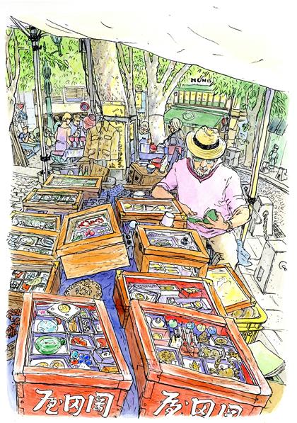 麻布十番パティオで月に一度の骨董市。商売っ気無く本を読んでいる男性を描かせていただきました。