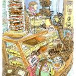 CACAO MARKET by MarieBelle。ガラスケースの中に積み上げられた量り売りのチョコレート。ハンマーで砕いた断面にはナッツがごろごろ